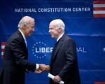 Joe Biden comforts John